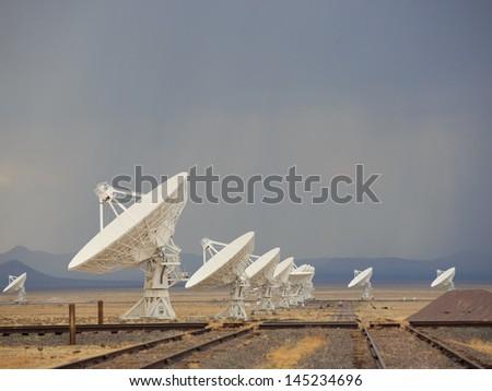 Thunderstorm looms over the Very Large Array, Radio Telescope near Socorro, New Mexico.  - stock photo