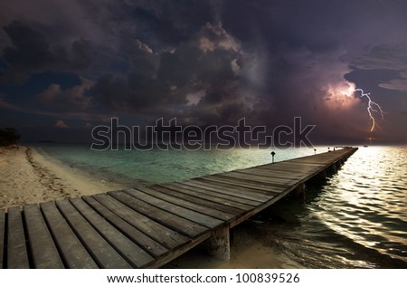 thunderstorm on beach - stock photo