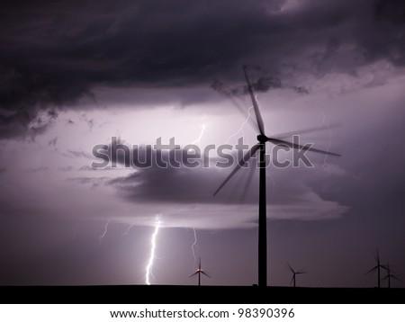 Thunderstorm over a wind farm - stock photo