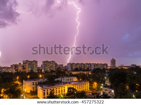 Thunderstorm over the city in the evening sky