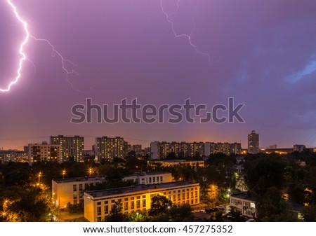 Thunderstorm over the city in the twilight sky