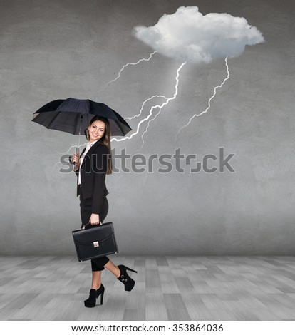 Thunderstorm strikes to businesswoman with umbrella in the gray room