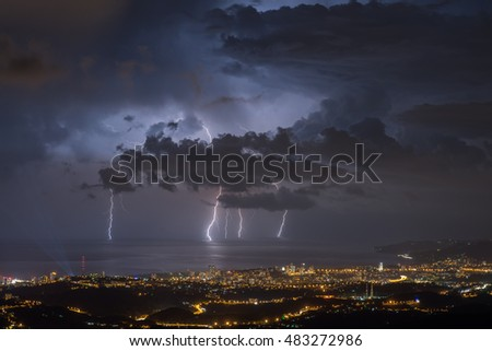 Thunderstorm with lightning over the city