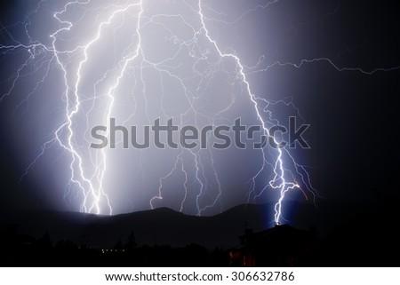 Thunderstorm with lightnings in a dark thunderous night - stock photo