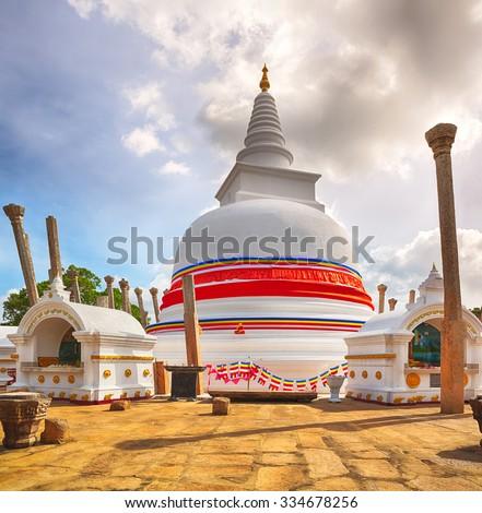 Thuparamaya dagoba in the sacred world heritage city of Anuradhapura, Sri Lanka.  - stock photo
