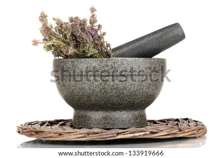Thyme herb and mortar on wicker mat isolated on white - stock photo