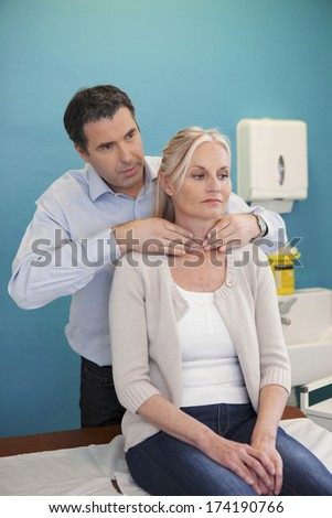 Thyroid Palpation, Elderly Person - stock photo