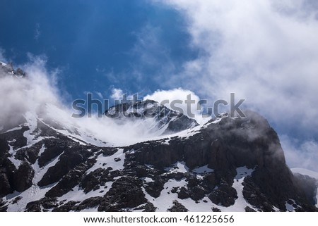 Tian-Shan Mountains landscape with clouds, Kazakhstan.