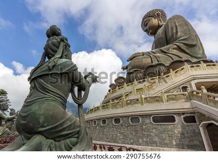 Tian Tan Buddha, aka the Big Buddha, is a large bronze statue of a Sakyamuni Buddha and located at Ngong Ping, Lantau Island in Hong Kong. - stock photo