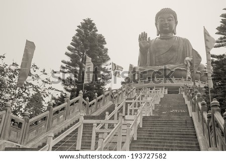 Tian Tan Buddha, also known as the Big Buddha, is a large bronze statue of Buddha located on Ngong Ping, Lantau Island, Hong Kong - stock photo