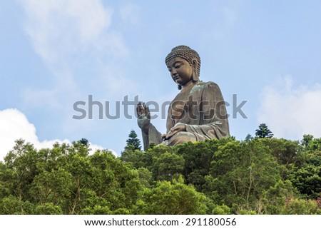 Tian Tan Buddha (Big Buddha) is a large bronze statue of a Sakyamuni Buddha and located at Ngong Ping Lantau Island in Hong Kong. - stock photo