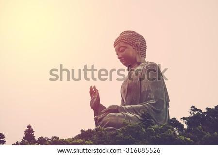 Tian Tan Buddha - The worlds's tallest bronze Buddha in Lantau Island, Hong Kong. Vintage filter.  - stock photo