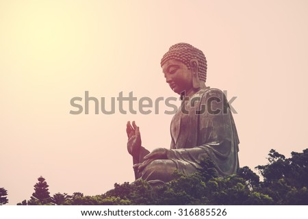 Tian Tan Buddha - The worlds's tallest bronze image in Lantau Island, Hong Kong. Vintage filter.  - stock photo