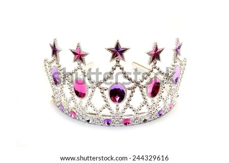 Tiara with pink and violet stones on white  - stock photo