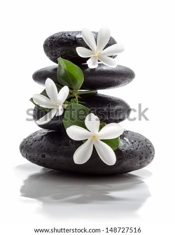 tiare flowers and tower black stone spa  - stock photo