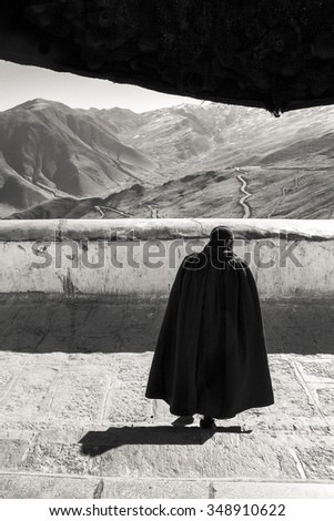 Tibet, China- February 3: Buddhist monk walking down the stairs of the tibetan monastery.