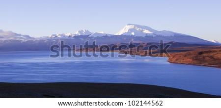 tibet: mount naimonanyi (or gurla mandhata) and lake mapham yumtso (or manasarovar) at sunrise - stock photo