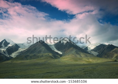 Tibet's snow-capped mountains in China - stock photo