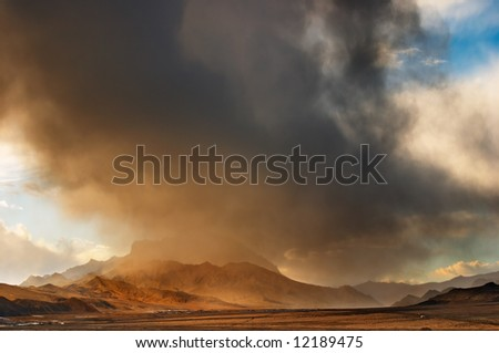 Tibetan landscape with storm clouds - stock photo