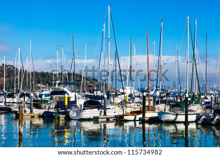 Tiburon, California yacht harbor with the San Francisco skyline in the background - stock photo