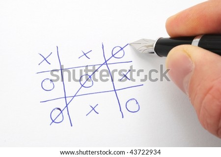 tic tac toe game on paper showing success concept