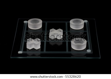 Tic-Tac-Toe on a black background. - stock photo