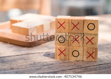 tic tac toe XO game,Wood Toys,warm light and vintage effect. - stock photo