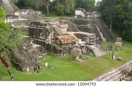 Tical maya site over green grass and tropical jungle
