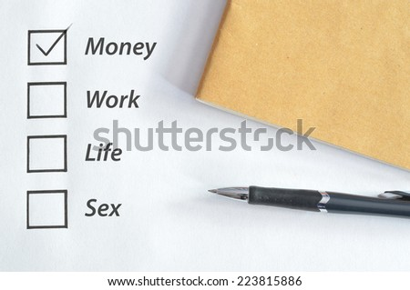 tick box for money with notebook and pen