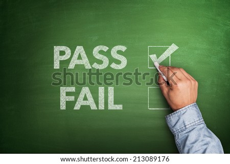 Tick boxes for Pass or Fail on blackboard  - stock photo