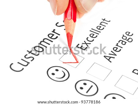 Tick placed in excellent checkbox on customer service satisfaction survey form - stock photo