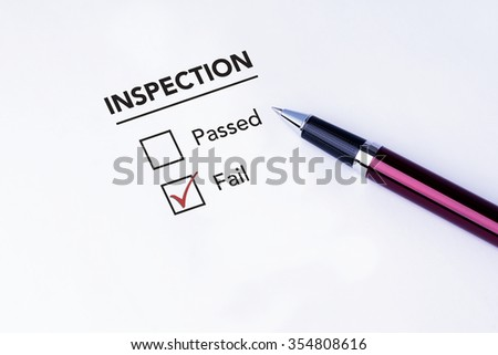 Tick placed in fail check box on inspection form with a pen on isolated white background. Business concept survey. - stock photo