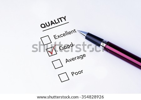 Tick placed in good check box on quality service satisfaction survey form with a pen on isolated white background. Business concept survey.