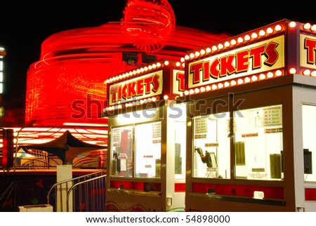 Tickets for Fun, part of the midway at the 2009 Douglas County Fair in Roseburg Oregon at night. - stock photo