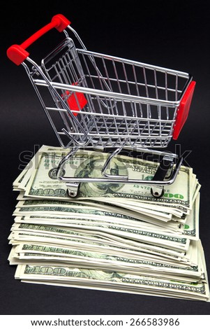 Tickets  one hundred dollars and shopping cart - stock photo