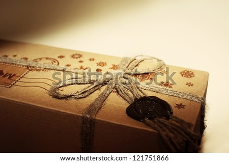 Tide Up Cardboard New Year Parcel with Sealing Wax and Bow - stock photo