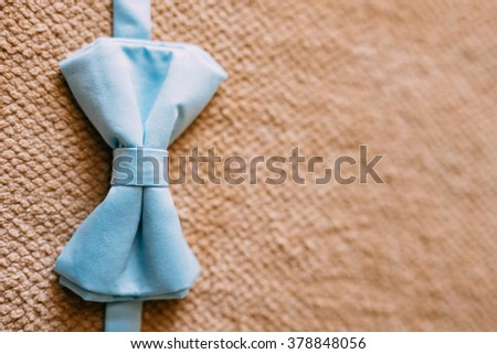 Tie Butterfly on a wooden background - stock photo
