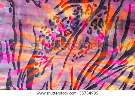 Tie dye design with black ink and bright colors on fabric. - stock photo