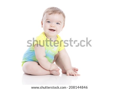 Tie-dyed.  Adorable little boy dressed in a tie-dyed onesie.  Isolated on white with room for your text.