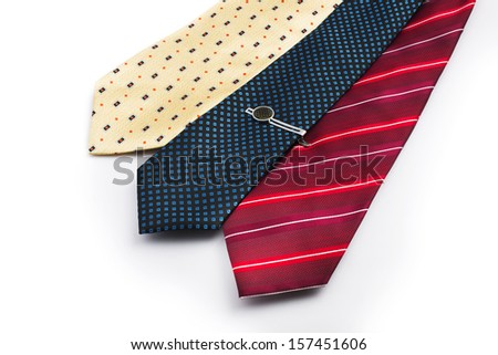 Tie, Tie-pin, Three ties of different colors. The blue tie with a tie pin. Shot on white background. - stock photo
