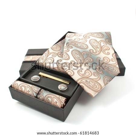 tie with cufflinks in a box on a white background - stock photo