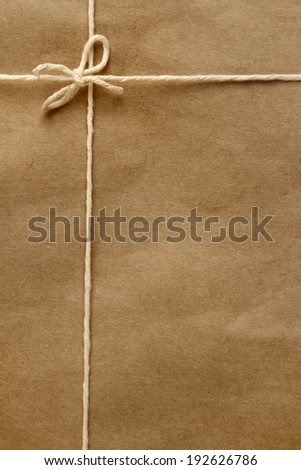 Tied knot on brown parcel
