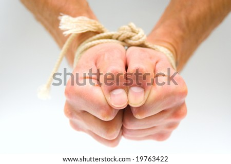 Tied male hands - stock photo