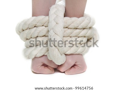 tied up female hands over white - stock photo