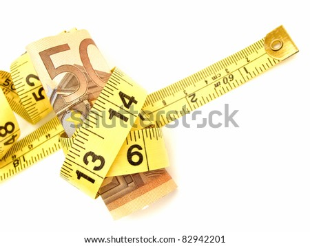 Tied up: Fifty Euro notes wrapped in a measuring tape - stock photo