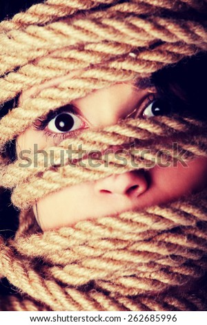 Tied up scared woman face. Violence concept. - stock photo