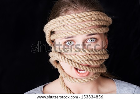 Tied up woman screaming. Violence concept.  - stock photo