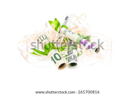 Tied with a green ribbon dollars in tinsel on a white background - stock photo