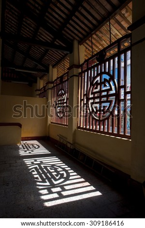 TIEN GIANG, VIETNAM, MAY 26, 2013. A view of window shadow in a temple on early morning. GO CONG, TIEN GIANG, VIETNAM, MAY 26, 2013