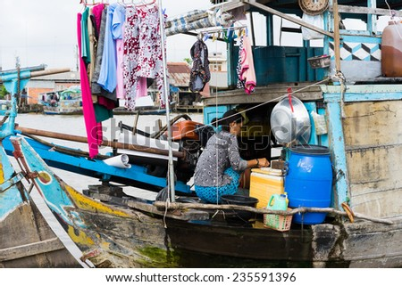 Tien Giang, Vietnam - Nov 28, 2014: Floating boat, the mobile house for people living in poverty on Tien river, Mekong delta - stock photo